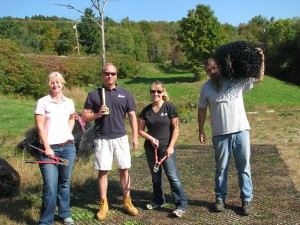 Employees volunteer with post-Irene cleanup at Couples Club in Waitsfield.