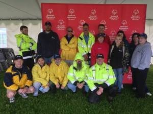 Employees volunteer to setup for the Vermont Special Olympics Summer Games.