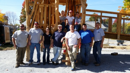Employees volunteer with playground build in Bristol.